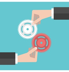 Two hands holding gears vector image