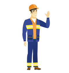 young asian builder waving his hand vector image