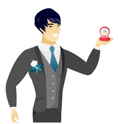 young asian groom holding wedding ring in box vector image