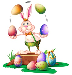 A bunny juggling the easter eggs vector image