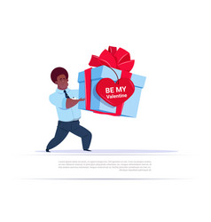 African american man holding big gift box with vector