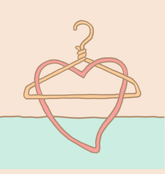 a funky coat hanger and heart vector image