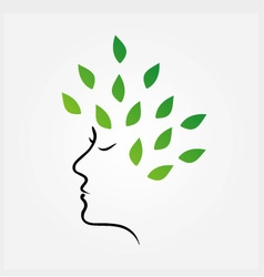 Womans face with green leaves as hair vector
