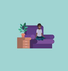 Teenager black boy seated in livingroom vector