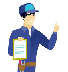 asian mechanic with clipboard giving thumb up vector image vector image
