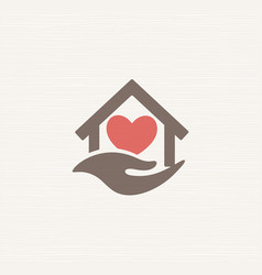 house with heart inside house and caring hand vector image
