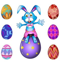 A bunny above the Easter egg vector image vector image