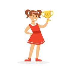 Happy school girl in red dress holding winner cup vector