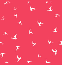 silhouettes of deer on pink background seamless vector image