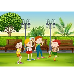 Boy and girl playing monkey in the park vector image