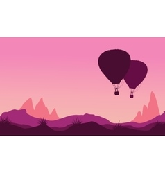 Silhouette of hot air balloon at sunset vector