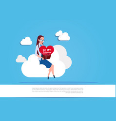 girl holding heart sit on white cloud over blue vector image