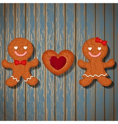 loving couple of gingerbread and heart cookie vector image