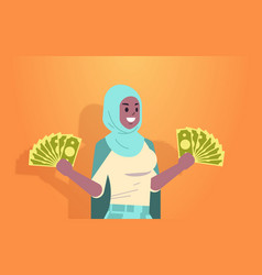 excited arabic woman holding money bills financial vector image