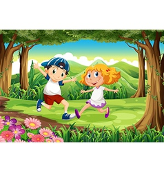 A forest with a young boy and girl vector image