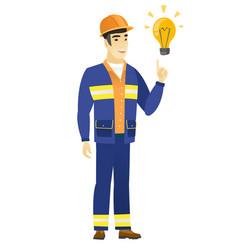 builder pointing at bright idea light bulb vector image