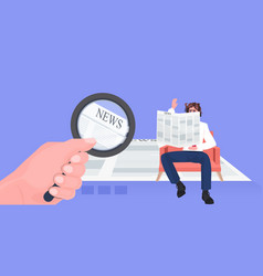 businessman holding magnifying glass reading vector image
