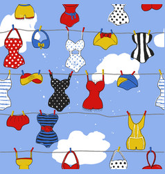 Trendy seamless pattern with cute swimsuits vector