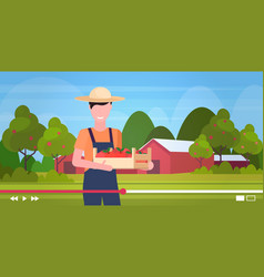 farmer blogger holding wooden box with apples man vector image