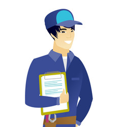 Young asian mechanic holding clipboard with papers vector