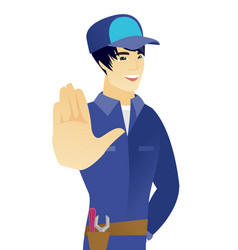 young asian mechanic showing palm hand vector image