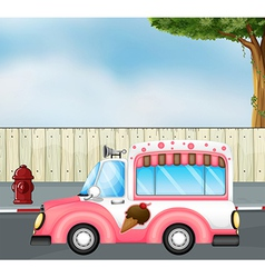 A pink ice cream bus at the road vector image