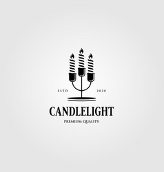vintage candle light flame logo in candle stick vector image