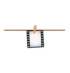 one photo film slide on a rope with clothepins vector image