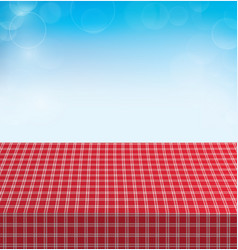 Picnic table covered with checkered tablecloth vector