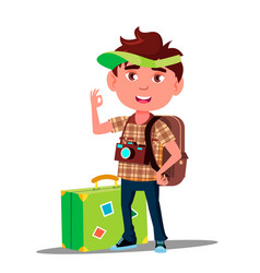 little traveler boy with suitcase cap on his head vector image