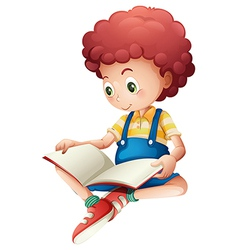 A young boy reading vector image vector image