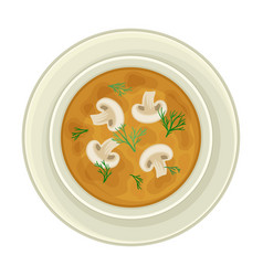 Cream soup with mushrooms served in bowl top view vector