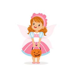 Sweet little girl in halloween costume standing vector