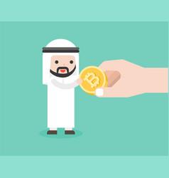 Arab businessman receive bit coin from big hand vector