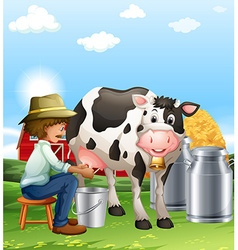 Farmer milking a cow at daytime vector