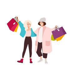 pair of happy teenage girls carrying shopping bags vector image