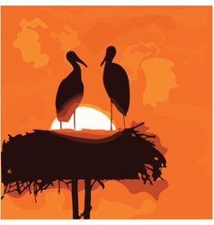 Pair of storks silhouettes in the nest vector