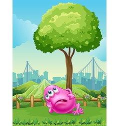 A tired pink monster under the tree vector