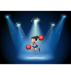 A cheerleader jumping in the middle of the stage vector image