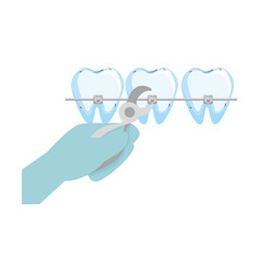 Human teeth with hand orthodontist and pliers vector