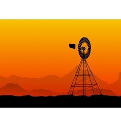silhouette of a water pumping windmill at the vector image