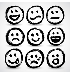 An icon set of grunge cartoon smiley faces vector