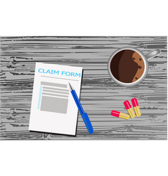 Claim form is on a grey wooden surface vector