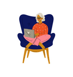 Young woman sitting in armchair working vector