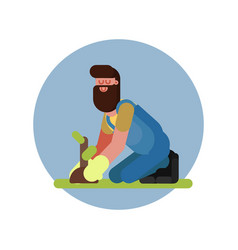 Man plants the plant on his knees vector