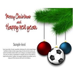 soccer ball hanging on a christmas tree branch vector image