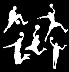 white silhouettes of a basketball player on a vector image