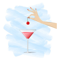 Womans hand puts a cherry in a cocktail on the vector