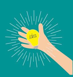 hand holding idea light bulb lamp shining line vector image