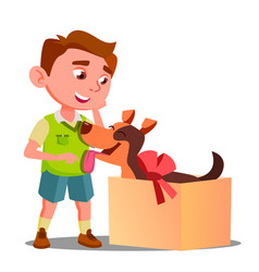 happy little boy takes out of gift box a dog vector image